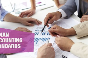A Group of Professionals Discussing | Indian Accounting Standards